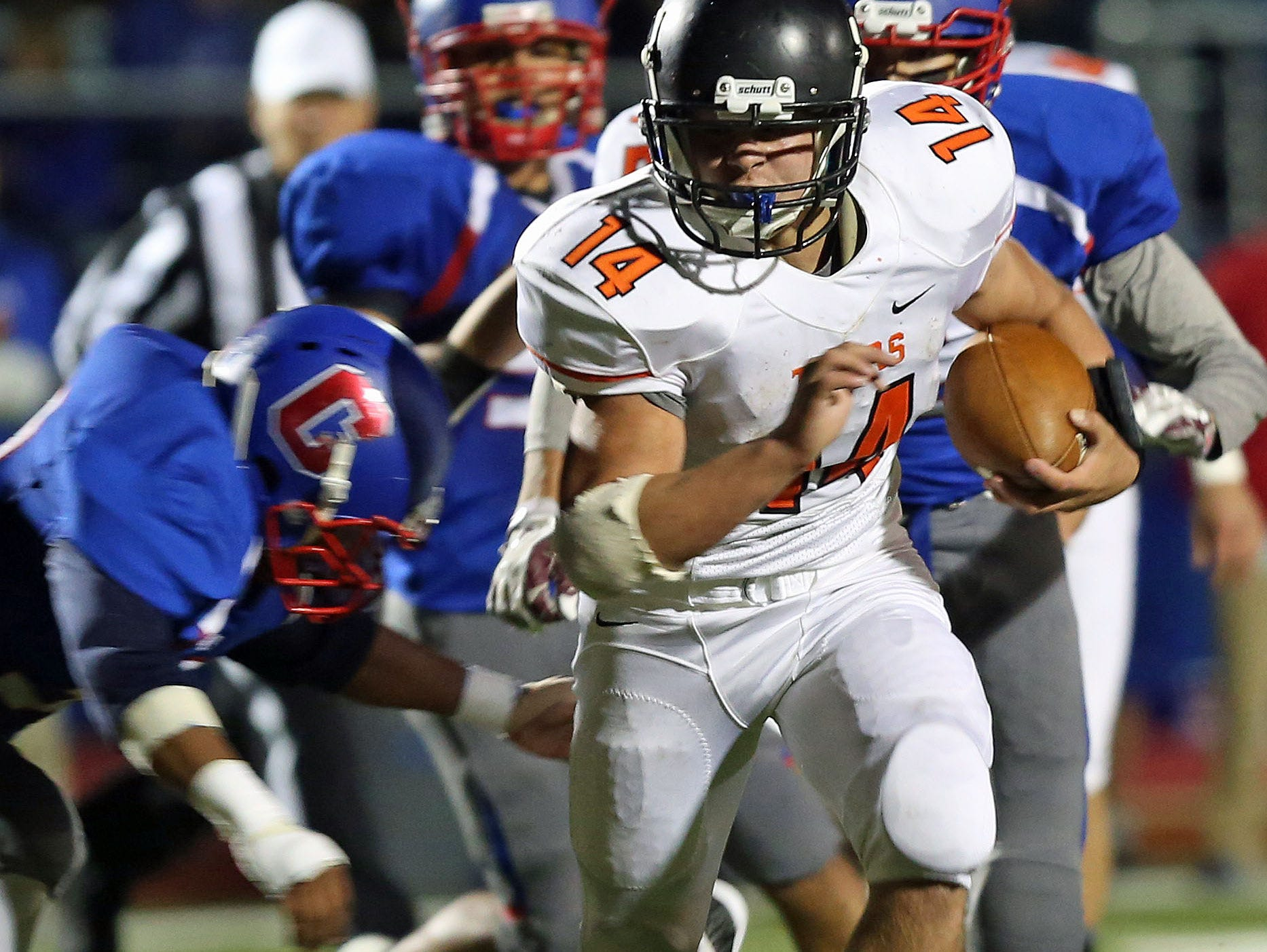 Mamaroneck's Daniel O'Rourke (14) finds some running room in the Carmel defense after a first half catch and run during a boys football playoff game at Carmel High School Oct. 16, 2015.