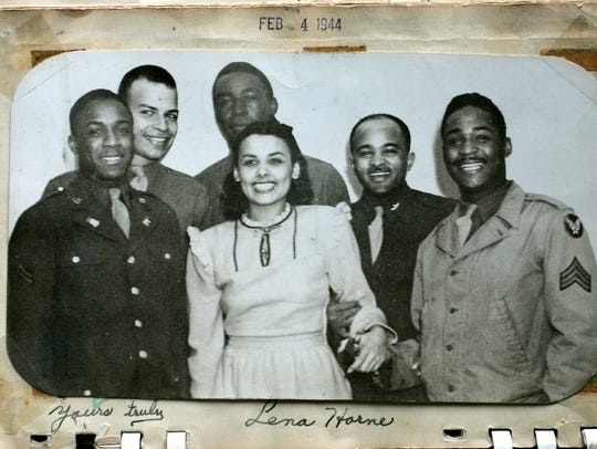 Lena Horne poses with a Tuskegee Airman and some friends.