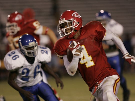 Palm Desert's James Dockery sees a break after making a catch and scoring for a touchdown against Rialto on Sept. 3, 2005.