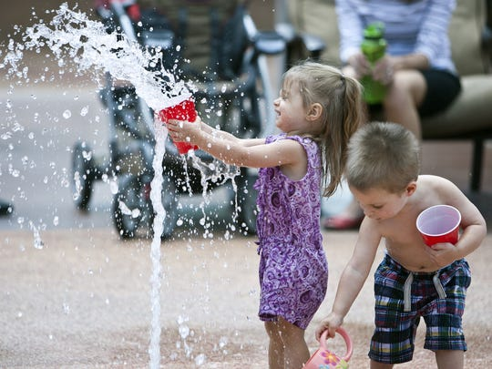 Red plastic cups add to the fun at the splash pad at