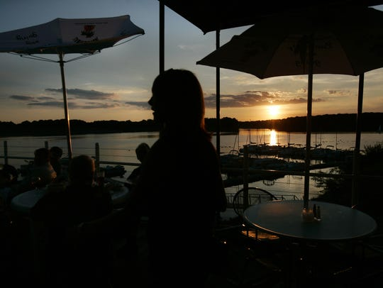 A beautiful sunset frames the deck at Rick's Cafe Boatyard,