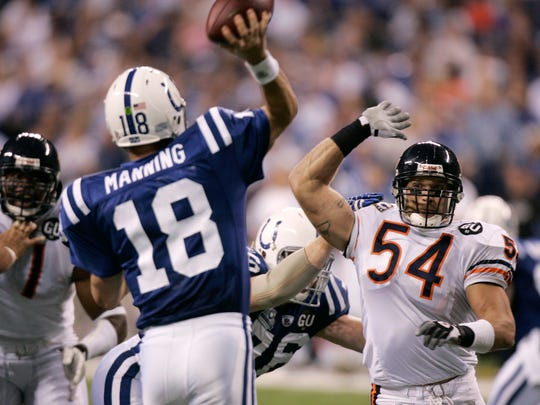Chicago Bears linebacker Brian Urlacher pressures Indianapolis Colts quarterback Peyton Manning during NFL football action in Indianapolis, Sunday, Sept. 7, 2008.  The Bears defeated the Colts 29-13.