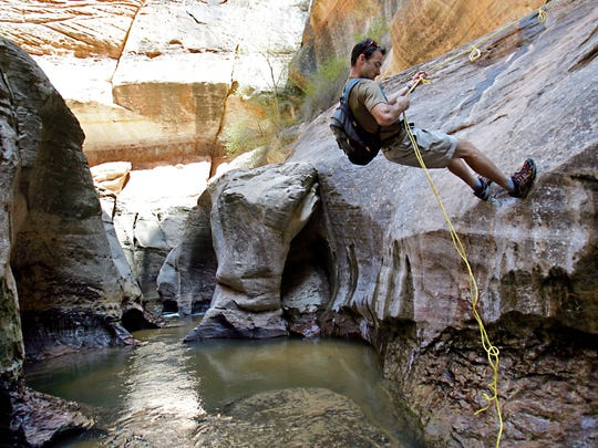 Brent Pontius of Ogden repels down a wall near Keyhole