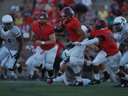 Dixie running back Orlando Wallace carries the ball on offense against Azusa Pacific on Saturday in St. George.