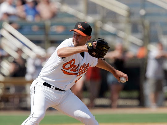 Baltimore Orioles pitcher Jamie Walker works during