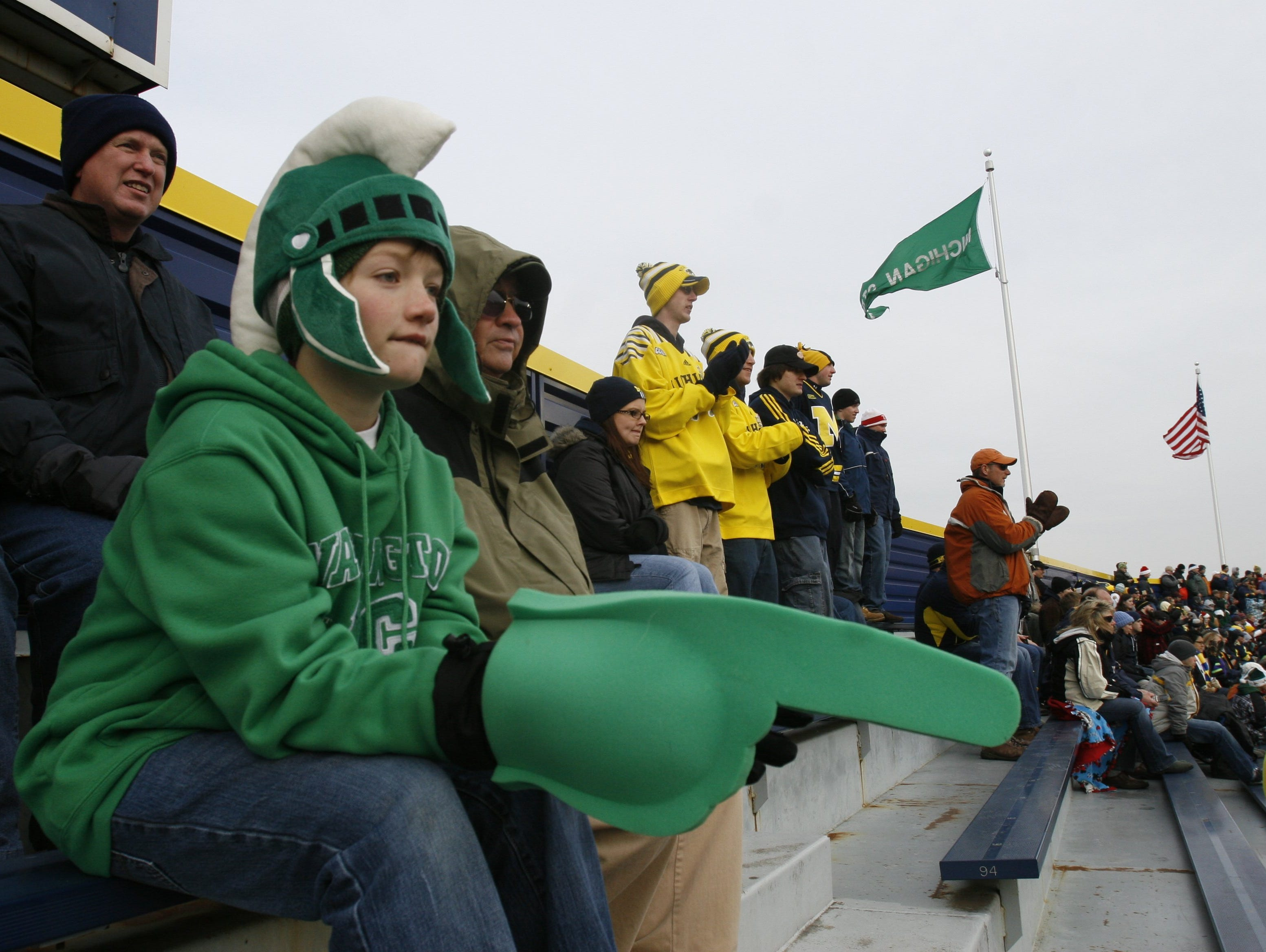 Michigan State fan Collin Turkelsomn, 11, of Charlevoix, MI watches the game at Big Chill game at Michigan Stadium .