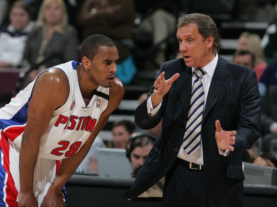 Detroit head coach Flip Saunders talks to rookie guard Arron Afflalo during 4th  quarter action between the Detroit Pistons and the Philadelphia 76ers in Game 5, Tuesday, April 29, 2008 at the Palace of Auburn Hills.