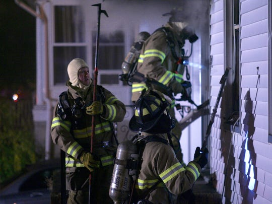 Fire at 80 Delafield St. before dawn Oct. 26, 2015.