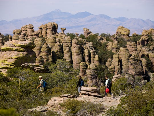 Hikers traverse the Heart of Rocks loop in Chiricahua National Monument near Willcox in southern Arizona.