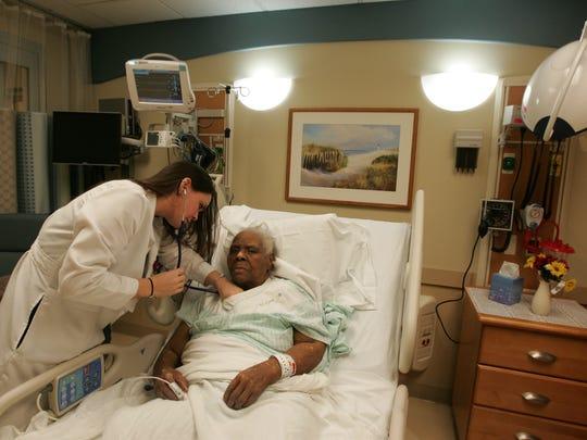 Nurse Angela Soldivieri examines Ella Tillman, 84, of Long Branch in the Geriatric Emergency Medical Unit at Monmouth Medical Center in Long Branch.