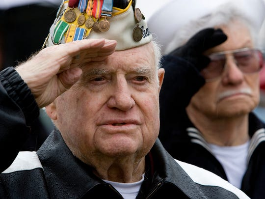 Pearl Harbor survivors Lee Warren and Carl Allen, right, salute as the National Anthem is sung during the 2009 Pearl Harbor Day ceremony at Vernon Worthen Park on Monday, Dec. 7 in St. George.