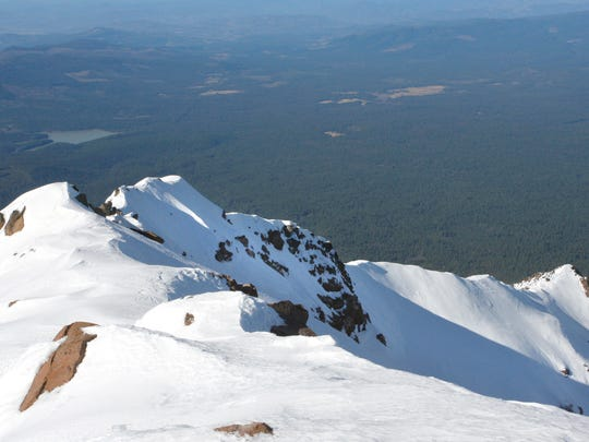 From Mount McLoughlin's 9,495 foot summit, the world seems to fall away.