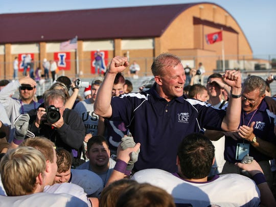 University of Sioux Falls head coach Kalen DeBoer reacts with his players after winning the 2006 NAIA Football National Championship Saturday in Savannah, TN.