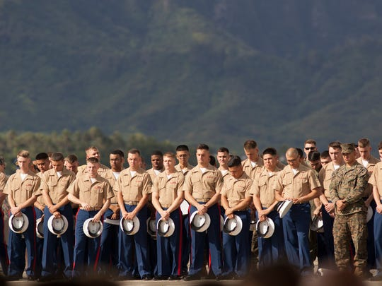 U.S. Marines attend a memorial service for the 12 Marines who died when their helicopters crashed off the North Shore of Oahu.