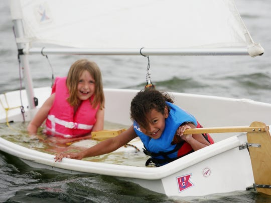 Zoey Hayes  and Jasmine Curry sail their waterlogged boat during Junior Sailing Camp offered through the Indianapolis Sailing Club in 2009.
