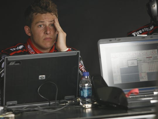 "A devastated Marco Andretti in his pit box after being caught  in the first crash of the day, on the first lap of the 2009 Indianapolis 500. ""I was gutted because nothing hurts as bad as being out at the start,"" Andretti says now."