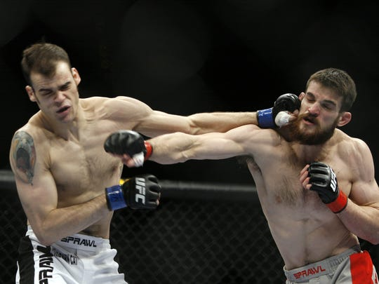 Dustin Hazelett, right, exchanges blows with Tamdan McCrory during their UFC match on Nov. 15, 2008, in Las Vegas.