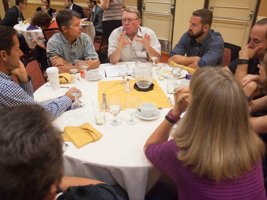 Rancher Link Leavens, center, speaks with others in attendance during a round-table discussion at a breakfast meeting about the economic effects of SOAR. The event was held Friday in Oxnard.
