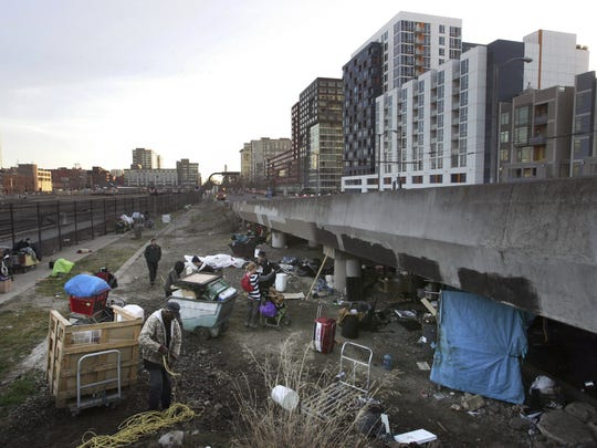 Homeless people pack up their belongings in February 2016 before the San Francisco Department of Public Works, in concert with Caltrans and law enforcement, cleared out their camp.