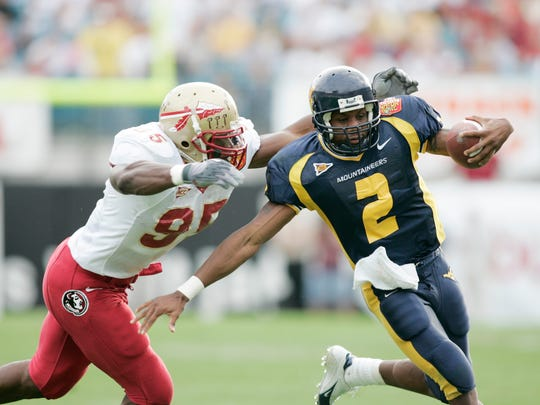 Florida State Seminoles defensive end Kamerion Wimbley chases West Virginia Mountaineers quarterback Rasheed Marshall during the third quarter in the 2005 Toyota Gator Bowl.