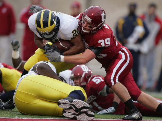 Michigan running back Mike Hart broke broke this tackle and went into the end zone for U-M's 2nd touchdown against Indiana's Will Meyers for a 14-0 lead in the 1st quarter on Nov. 11, 2006 in Bloomington. U-M won 34-3.