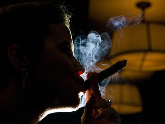 0430 Smoking Ban Sandi York Smokes at Morton's
