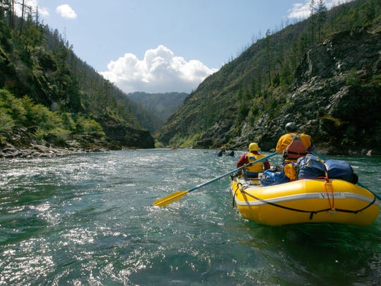 A rafting group led by Will Volpert heads into the canyons of the Illinois River.
