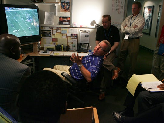 Greg Cosell (black shirt in back) is one of the most widely-respected QB evaluators. Here, he's at NFL Films with, among others, former NFL QB Ron Jaworski (in chair).