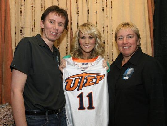 Ewa Laskowska, left, Carrie Underwood, center, and