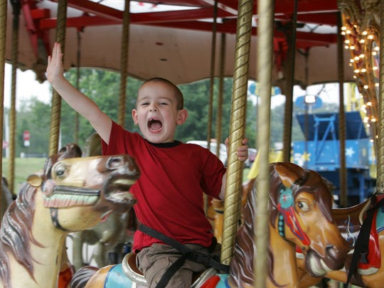 Randolph July 6, 2008 Nicholas Rodeguiez, 5, rides the Merry Go Round at the Freemdom Festival Carnival held at County College of Morris in Randolph New Jersey.