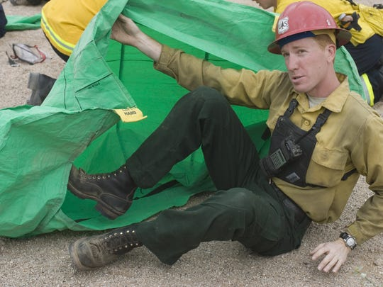 Jason Allred, a US. Forest Service engineer, demonstrates