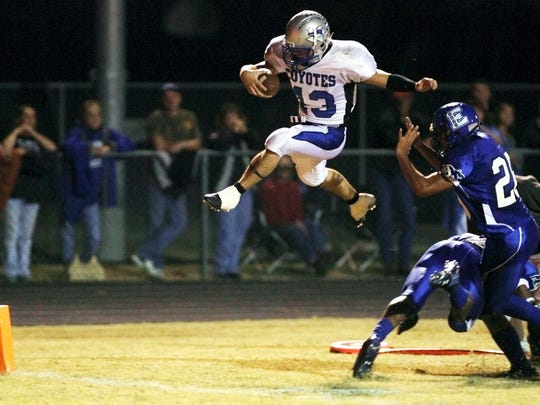 Richland Springs' Tyler Ethridge leaps over Eden defenders for a touchdown in a game Nov. 2, 2007.