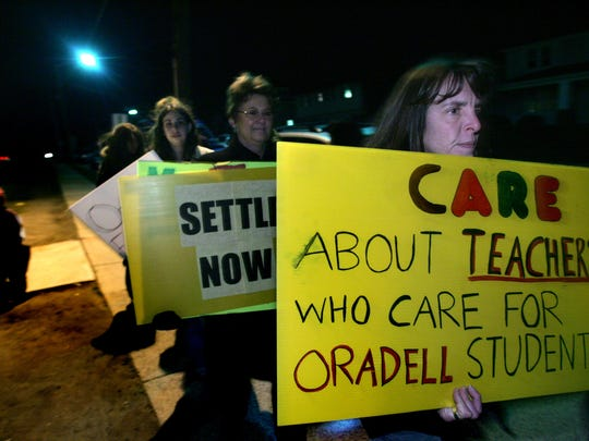 Oradell teachers held a rally outside the Oradell Public School on Jan. 8, 2007, in a show of solidarity. About 75 people turned out including parents and students. The group marched and carried signs.