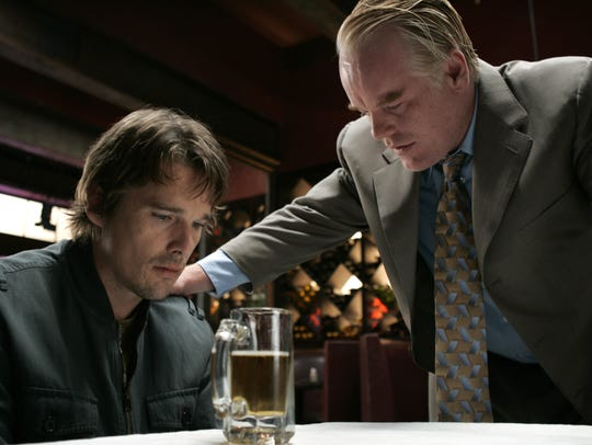Hank (Ethan Hawke, left) and Andy (Philip Seymour Hoffman)
