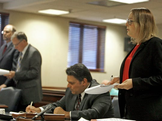 Deputy Attorney General Mallory Shanahan speaks before Superior Court Judge James Den Uyl at the sentencing of Scott MacFadden, far left, at the Ocean County Courthouse Sept. 29, 2017.