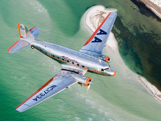 Original 1937 American Airlines vintage DC-3 flies over Florida beaches.
