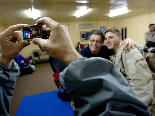 Al Franken gets his photo taken with a soldier after the Sergeant Major of the Army  USO ( United Service Organization) Hope and Freedom tour 2005 at Camp Victory, Baghdad Dec. 21 2005.