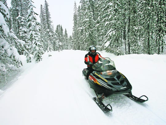 Steve Roe snowmobiles on the rounds surrounding Diamond