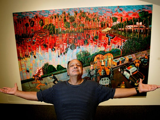 "Cheech Marin poses with ""The Arrest Of The Paleteros (The Arrest Of The Popsicle Sellers) 1996,"" one of some 50 art works by Latino artists, that will be shown at the Los Angeles County Museum of Art. Marin will be in Corpus Christi Jan. 11, 2018."