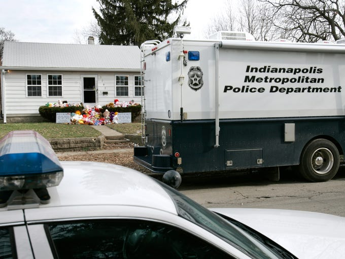 An IMPD RV and a police car sit in from of 3283 Hovey