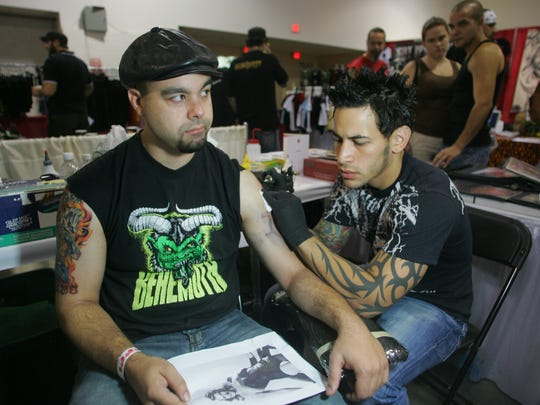 2007: Nick Garndinetti, of Union, gets a tattoo of