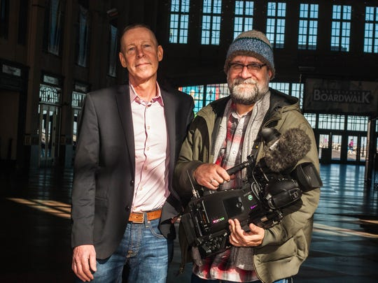 Russell Cheek, left, of RCM Marketing Communications meets with his director of photography, Ted Yasi, in Asbury Park.