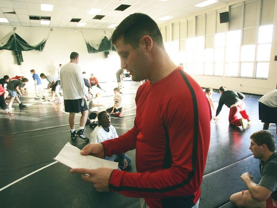 Coach Scott Goodale, at Jackson in 2005, reviews practice schedule.