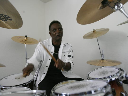 Alvin Taylor plays the drums at his house in Cathedral