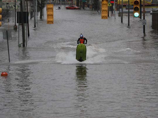 Some water enthusiasts used their Jet Skis and kayaks Saturday to take advantage of the flooding that occurred in Kalamazoo.