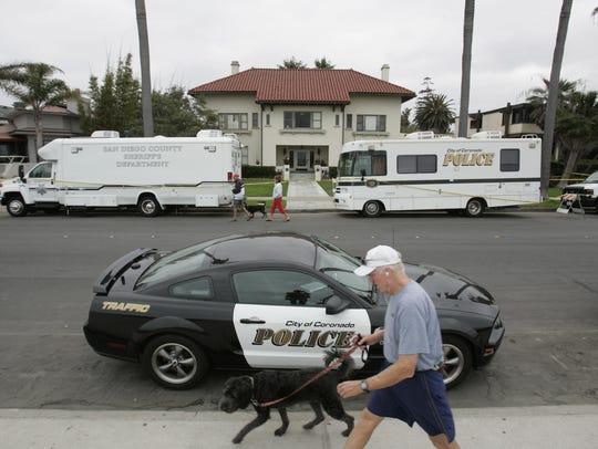 Coronado police and the sheriff investigate the scene
