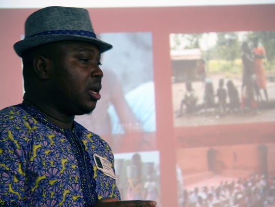 Victor Ayara teaches students at Indianola's Emerson