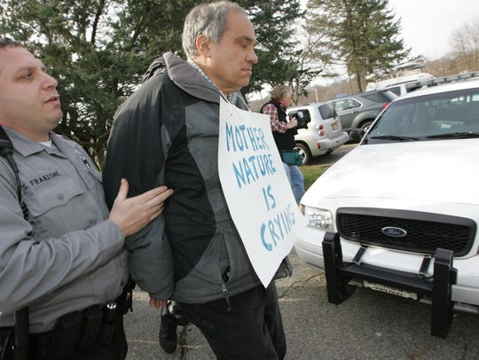 Bill Crain being arrested at a bear hunt protest in Franklin in December of 2011.