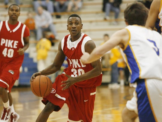 Pike's Marquis Teague, 30, makes a move to get around Carmel defender Robert Kitzinger. In the background for Pike is Julian Strickland. Carmel hosted Pike in boys basketball 1/20/10 at Carmel H.S.