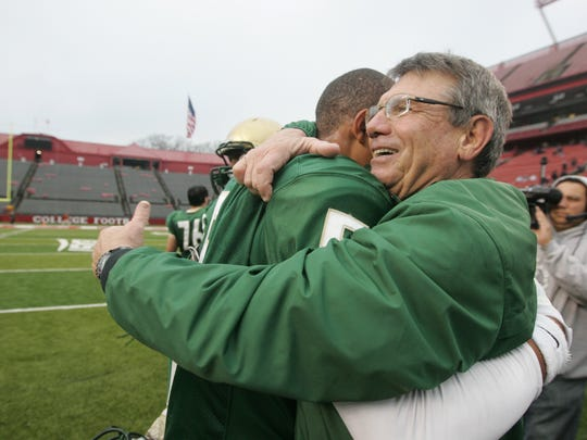 12/8/12:  Ricky Jeune hugs head coach Tony Karcich at the mend of the Non-Public Group III Championship game.